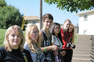 Mass Communications students practice photography skills on campus.