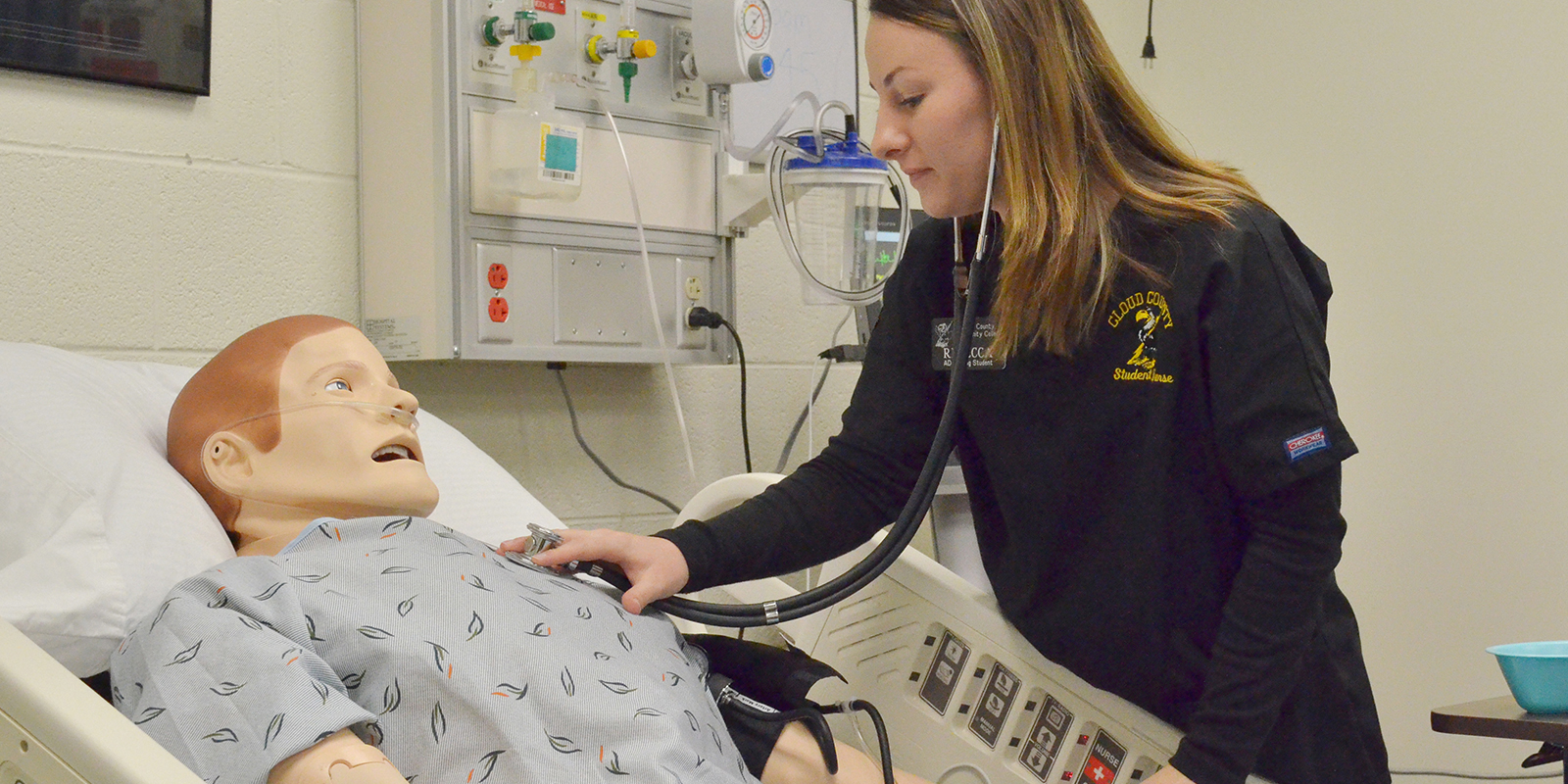 A nursing student checking vital signs.