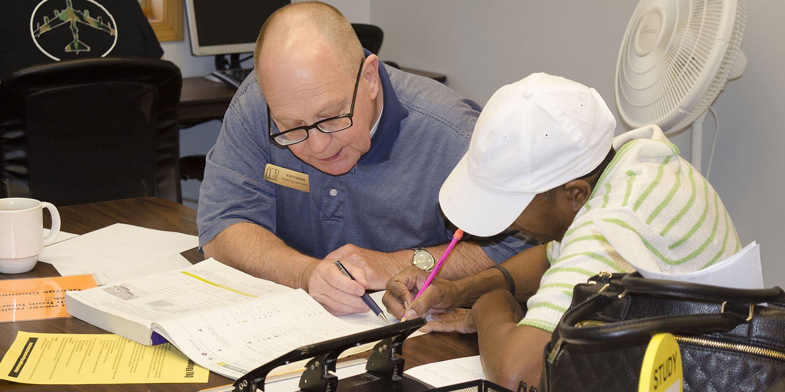 An instructor helping a student with an assignment.