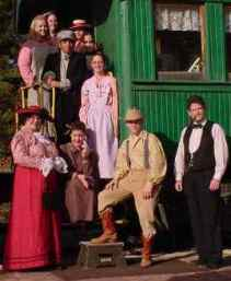 Railroad car with cast members of the Orphan Train play, The Chosen