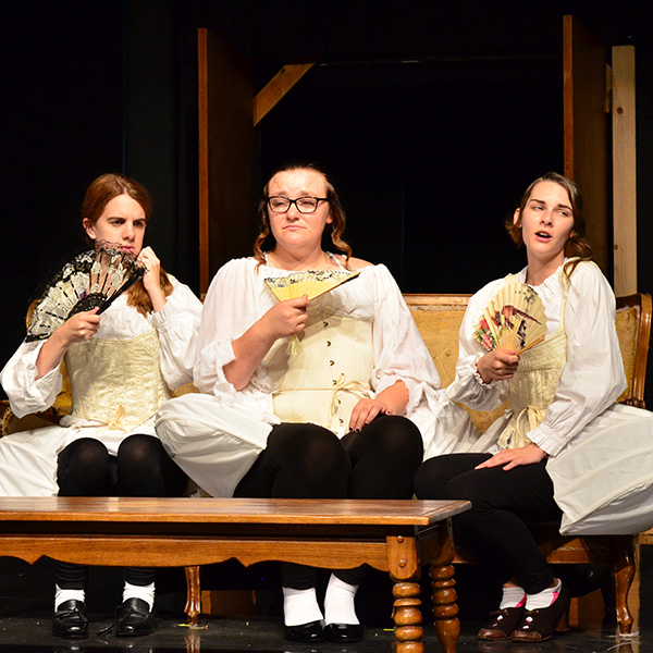 "A photo of cast members in the fall play, ""Tartuffe."""